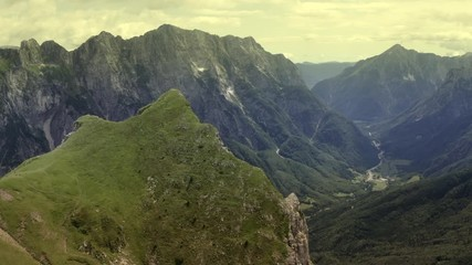 Wall Mural - Aerial Scenic Footage of Road to Mangart Mountain Region in the Julian Alps of Slovenia, Europe.