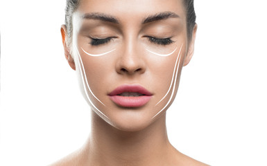 Fototapeta Face lift treatment anti aging skincare woman concept. woman face with lifting lines on white background. obraz