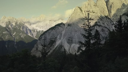 Wall Mural - Aerial Footage of Scenic Front Window Mountain or Mount Prisojnik During Summer Late Afternoon. Slovenia, Europe.