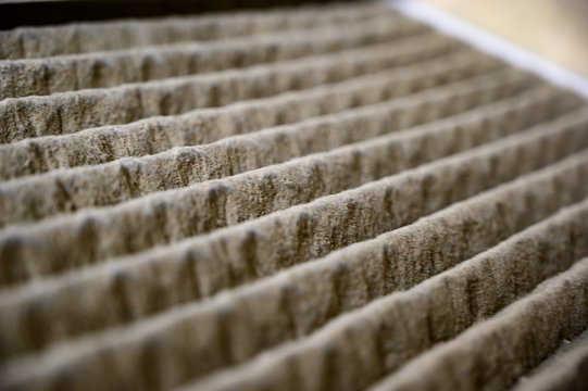 Dirty and dusty used house air filter close-up