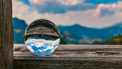 Crystal ball alpine landscape shot at Aurach near Kitzbühel, Tyrol, Austria