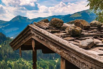 Beautiful alpine view with a wooden house at Aurach near Kitzbühel, Tyrol, Austria