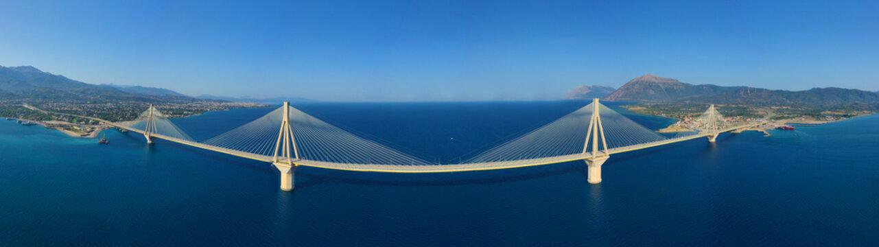 Aerial drone panoramic photo of world famous cable suspension bridge of Rio - Antirio Harilaos Trikoupis, crossing Corinthian Gulf, mainland Greece to Peloponnese, Patras