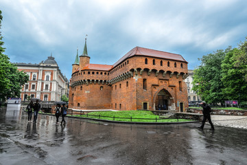 Krakow Barbican and rainy cityscape.