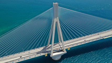 Staande foto Bruggen Aerial drone photo of world famous cable suspension bridge of Rio - Antirio Harilaos Trikoupis, crossing Corinthian Gulf, mainland Greece to Peloponnese, Patras