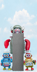 Wall Mural - retro robots holding a big  metal letter i with blue sky