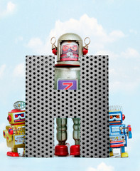 Fototapete - retro robots holding a big  metal letter H with blue sky