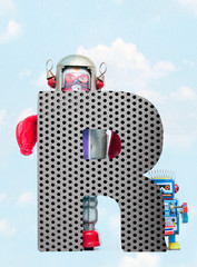 Fototapete - retro robots holding a big  metal letter  R with blue sky