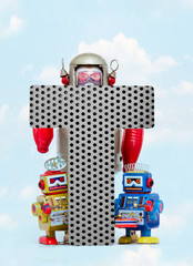 Fototapete - retro robots holding a big  metal letter  T with blue sky