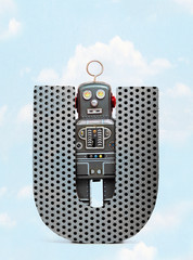 Wall Mural - retro robots holding a big  metal letter  U with blue sky