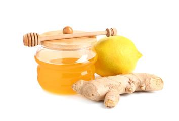 Jar of fresh honey, lemon and ginger on white background