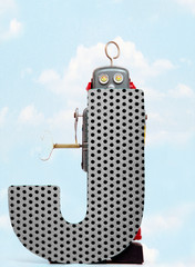 Wall Mural - retro robots holding a big  metal letter J with blue sky