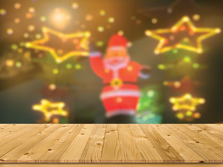 Brown old plank wooden board as a shelf with blurry Santa and Xmas celebrate lighting for insert text or picture background. Beautiful texture and pattern of empty pine wood table for display mock-up.