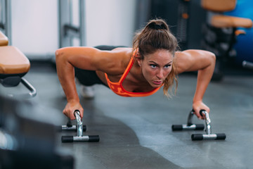 Female Athlete Doing Push-Ups in The Gym