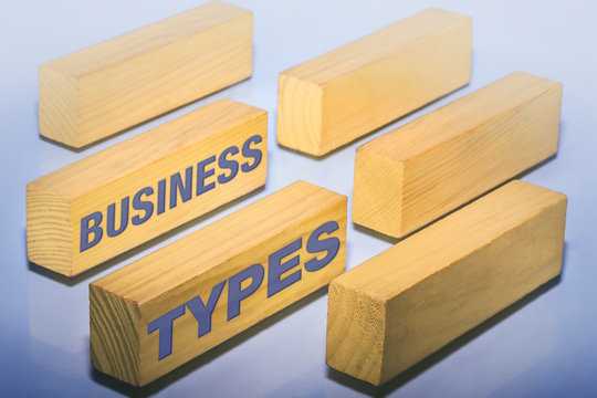 Business types showing blank wooden pieces as place holders for different legal entities.
