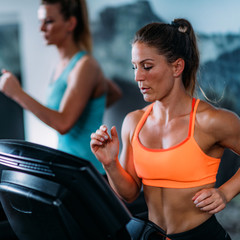 Women Exercising on Treadmill.