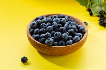 Fresh berry in wooden bowl