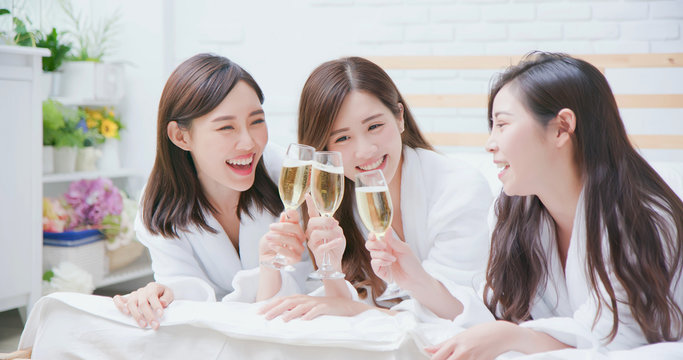 asian women friend have champagne