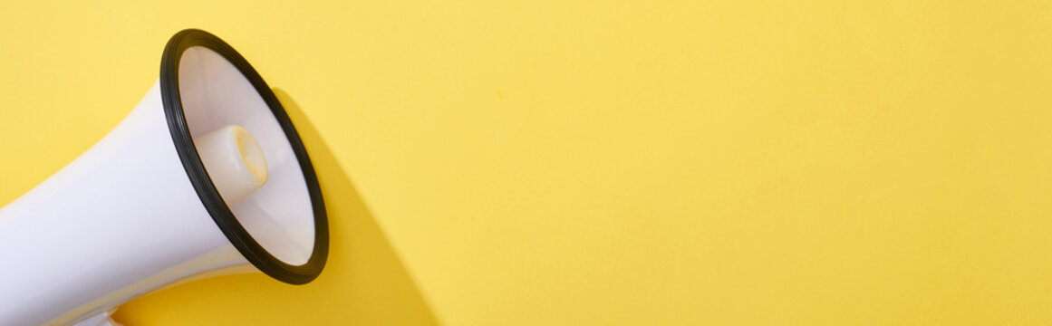 panoramic shot of loudspeaker on bright and colorful background