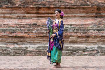 Beautiful young Muslim girl wearing hijab and dress known as Baju Kurung fashion, traditional Muslim dress, hijab, burka, niqab
