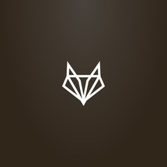 white sign on a black background. simple vector line art geometric sign of an abstract fox or wolf head