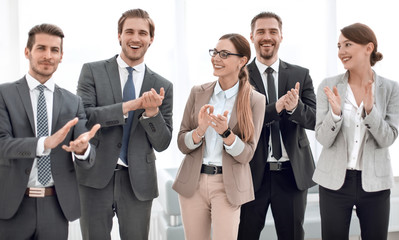 smiling business team applauds their success