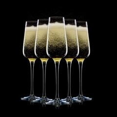 Set of luxury champagne glasses in a row isolated on a black background