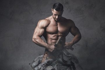 Bodybuilder made himself from the piece of stone. Concept of self improvement and bodybuilding progress. Wall mural