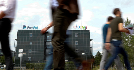 People walk past German headquarters offices of PayPal and eBay at Europarc Dreilinden business park south of Berlin in Kleinmachnow
