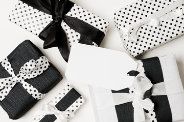 Various types of gift box wrapped in black and white design paper