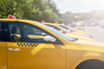 Image of yellow taxi on street in summer