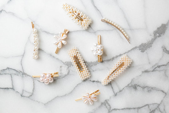 White Pearl Hair clips on marble, group of trendy hair accessories