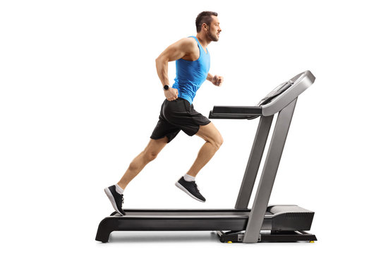 Young man in sportswear running on a professional treadmill