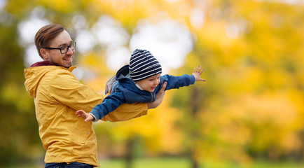 family, childhood and fatherhood concept - happy father and little son playing and having fun...