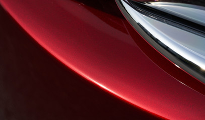 Close up detail of red metallic paint coating car body