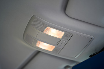 Vehicle interior of a modern car with lights on