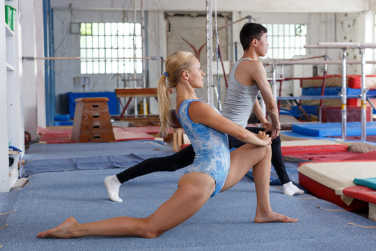 Man and woman doing exercises on floor