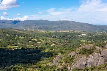 Beautiful aerial view of Serra do Cipo in Minas Gerais with forests and rock mountains in sunny summer day with blue sky. Landscape of the Brazilian Cerrado, one of the most devastated biomes. Wall mural