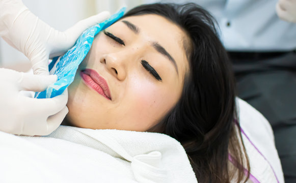 A beautiful woman got cold compress before botox injection