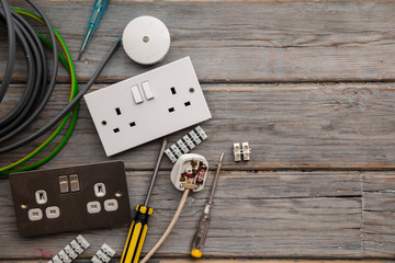 Electrical tools and equipment on a wooden background Fototapete