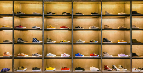 Lots of different sneakers on the showcase on market. Image of sport shoes on shop-window