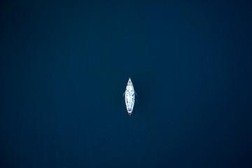 Fotobehang Bloemen top view of a beautiful sailboat in the sea