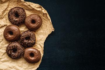 Top view of tasty homemade chocolate doughnuts