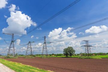 transmission line in a plowed field / daylight picture fields of Ukraine