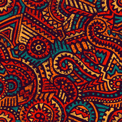 Seamless african pattern. Ethnic and tribal motifs. Orange, red, yellow, blue and black colors. Grunge texture. Vintage print for textiles. Bohemian hand-drawn ornament. Vector illustration.