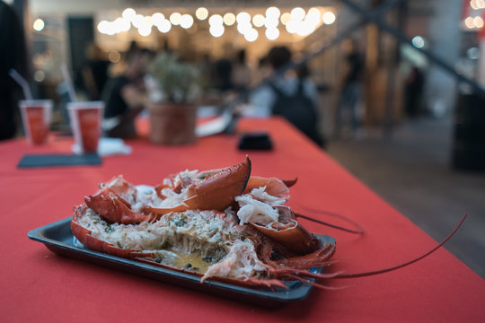 fresh red boiled lobster in paper plate on food festival