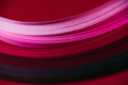 Abstract pink and red paper wave pattern