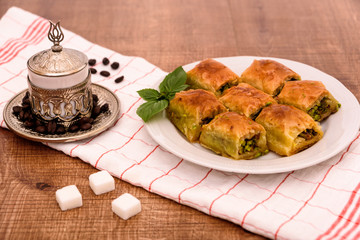 Turkish delights - baklava traditional sweets with turkish coffee, sugar and coffee beans