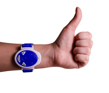 Isolated anti snoring wristband on hand. Watch  and sleeping aids.