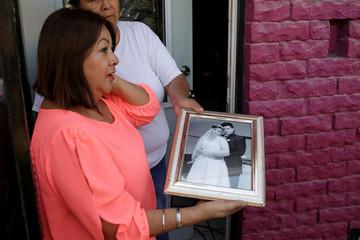 Josefina Manzano shows a picture of her son Ivan Filiberto Manzano, 46, who died in the El Paso Walmart shooting, in Texas, U.S., at her house in Ciudad Juarez